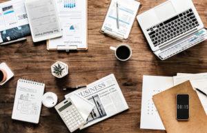 market statistics papers on desk